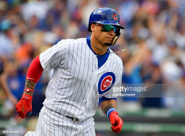 Chicago Cubs shortstop Javier Baez runs to first base after hitting a home run during the game between the Cincinnati Reds and the Chicago Cubs on...