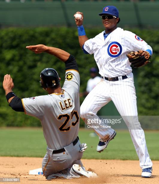 Chicago Cubs shortstop Starlin Castro gets the out against the Pittsburgh Pirates' Derrek Lee in the fifth inning at Wrigley Field in Chicago...