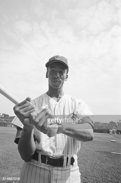Chicago Cubs' star shortstop Ernie Banks grips a baseball bat as he stands on the grass at Wrigley Field He has hit 42 home runs thus far in the 1958...
