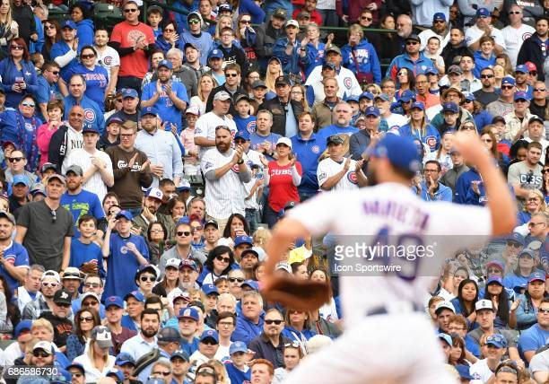 Chicago Cubs Starting pitcher Jake Arrieta delivers a pitch as Cub fans rise to their feet during a MLB game between the Chicago Cubs and Milwaukee...