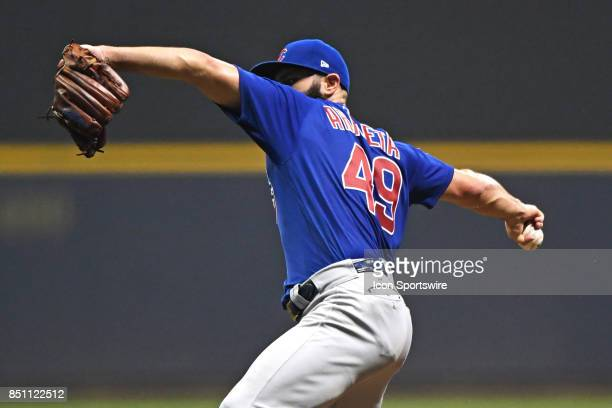 Chicago Cubs starting pitcher Jake Arrieta pitches in the third inning during a game between the and the Chicago Cubs the Milwaukee Brewers on...