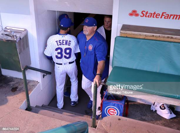 Chicago Cubs starting pitcher JenHo Tseng passes by pitching coach Chris Bosio before Tsung's major league debut against the New York Mets at Wrigley...