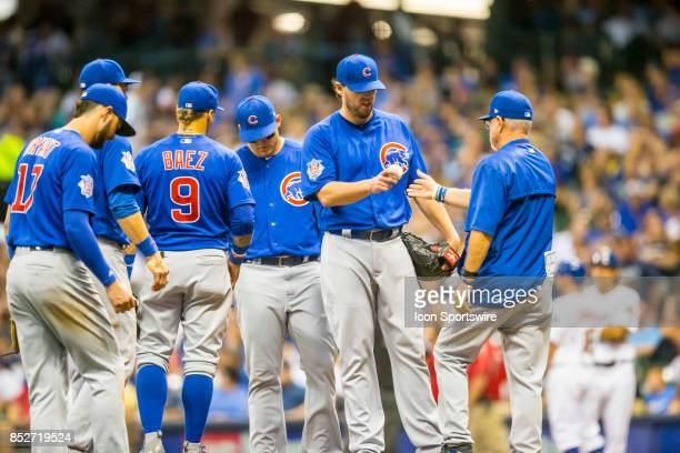 Chicago Cubs Starting pitcher John Lackey hands over the ball during the second game of the final home series between the Milwaukee Brewers and the...