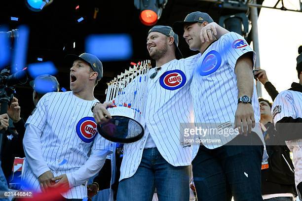 Chicago Cubs starting pitcher Jon Lester holds the commissioner trophy with Chicago Cubs first baseman Anthony Rizzo next to Chicago Cubs left...
