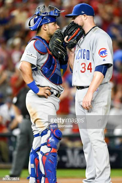 Chicago Cubs starting pitcher Jon Lester talks with catcher Willson Contreras during game two of the NLDS between the Chicago Cubs and the Washington...