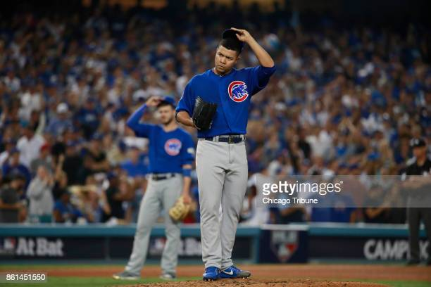 Chicago Cubs starting pitcher Jose Quintana frowns after giving up an RBI double in the fifth inning against the Los Angeles Dodgers during Game 1 of...