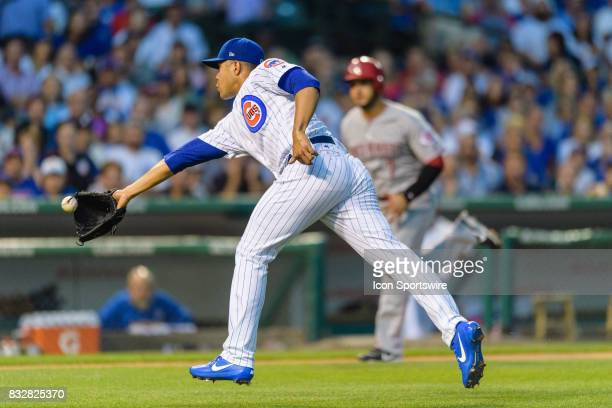 Chicago Cubs starting pitcher Jose Quintana receives an error fielding and throwing a ball home with his glove allowing Cincinnati Reds outfielder...