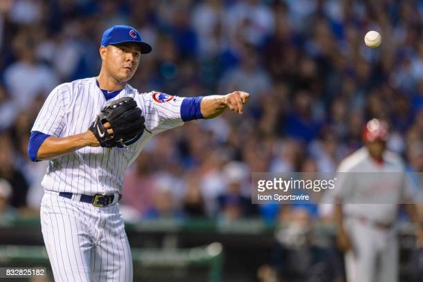 Chicago Cubs starting pitcher Jose Quintana throws out Cincinnati Reds first baseman Joey Votto in the 2nd inning during an MLB game between the...