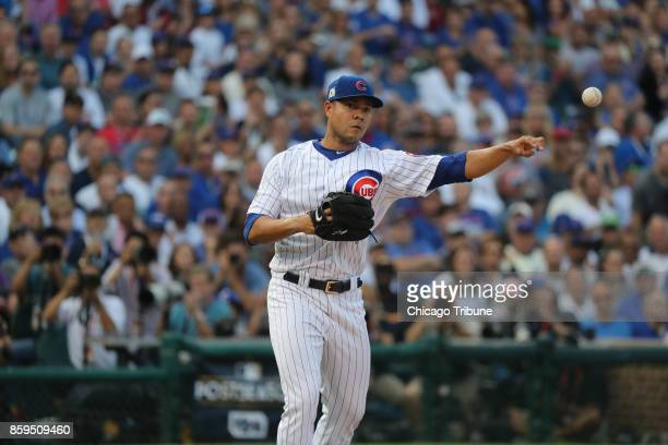 Chicago Cubs starting pitcher Jose Quintana throws to first base to get Washington Nationals shortstop Trea Turner out at the start of Game 3 of a...