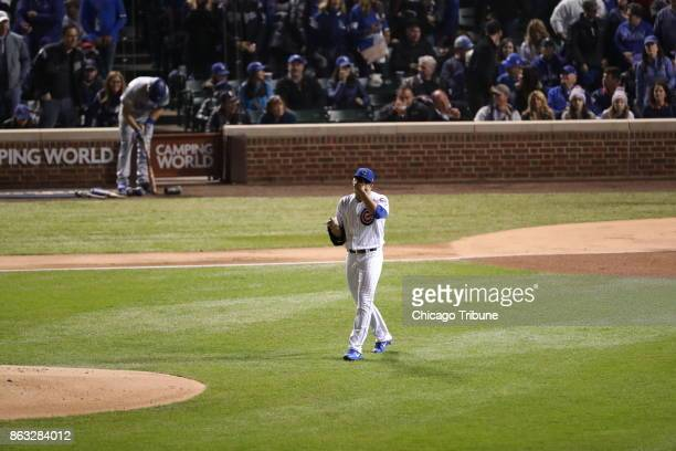 Chicago Cubs starting pitcher Jose Quintana walks back to the mound after giving up an RBI double to the Los Angeles Dodgers' Cody Bellinger in the...