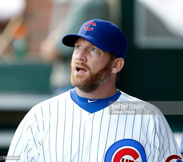 Chicago Cubs starting pitcher Ryan Dempster looks out from the dugout before the start of the game against the Pittsburgh Pirates at Wrigley Field in...