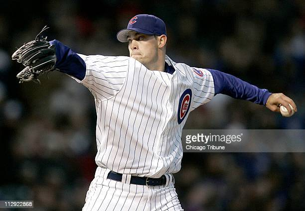 Chicago Cubs' starting pitcher Sean Marshall fires a ball in the first inning during his major league debut against the St Louis Cardinals at Wrigley...