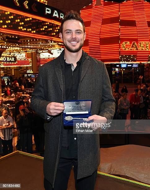 Chicago Cubs third baseman and Major League Baseball 2015 National League Rookie of the Year Kris Bryant holds a ceremonial key to the city of Las...
