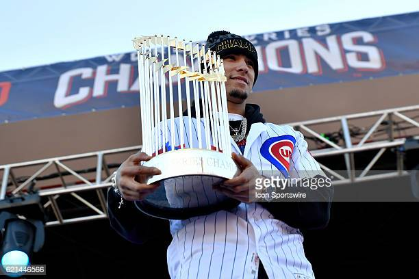 Chicago Cubs third baseman Javier Baez holds up the commissioners trophy during the Chicago Cubs World Series victory rally on November 4 at Grant...