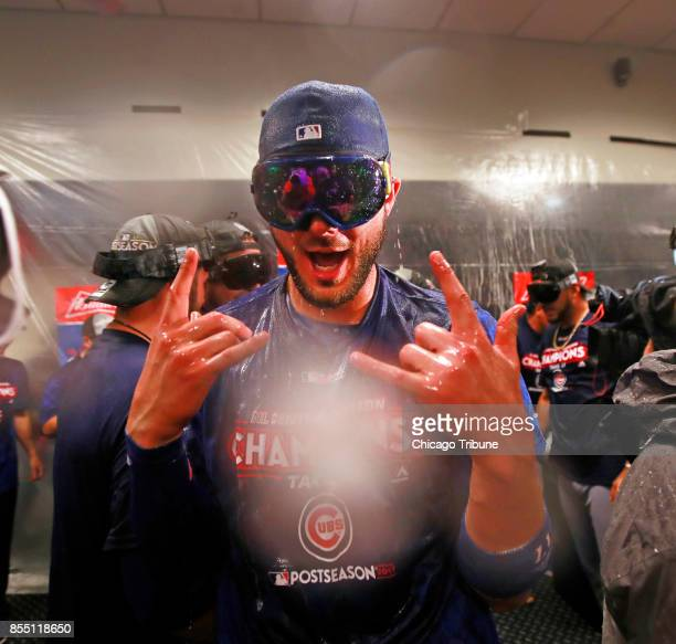 Chicago Cubs third baseman Kris Bryant celebrates after the team clinched the National League Central Division with a 51 win against the St Louis...