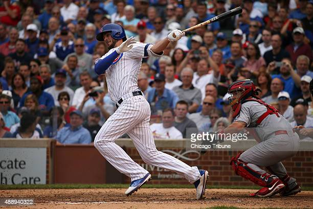 Chicago Cubs third baseman Kris Bryant connects with the ball only to be thrown out at first during the sixth inning on Friday Sept 18 at Wrigley...