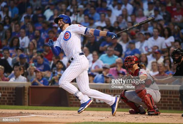 Chicago Cubs third baseman Kris Bryant doubles against the Cincinnati Reds during the first inning of their game at Wrigley Field Monday Aug 14 2017...