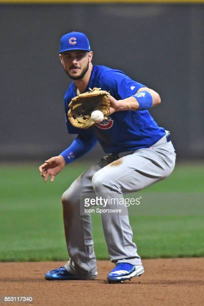 Chicago Cubs third baseman Kris Bryant fields a ground ball during a game between the and the Chicago Cubs the Milwaukee Brewers on September 21 at...