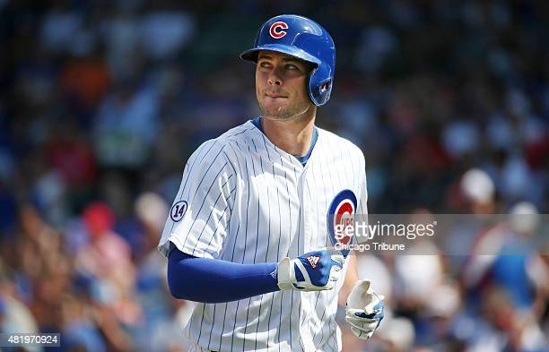 Chicago Cubs third baseman Kris Bryant looks up at the scoreboard after flying out against the Philadelphia Phillies in the first inning at Wrigley...