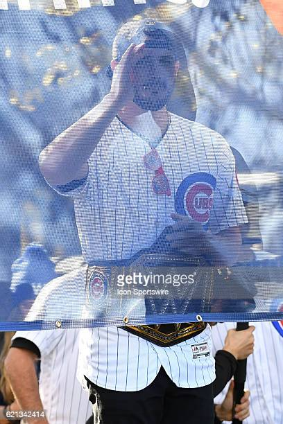 Chicago Cubs third baseman Kris Bryant peaks through a banner during the Chicago Cubs World Series victory rally on November 4 at Grant Park in...