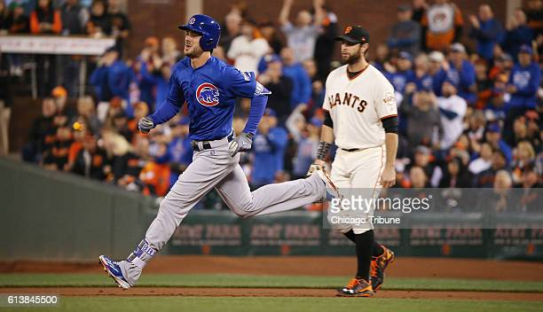 Chicago Cubs third baseman Kris Bryant rounds first base on his first inning double past San Francisco Giants first baseman Brandon Belt on Monday...