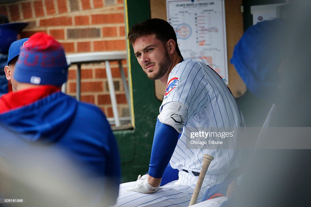 Chicago Cubs third baseman Kris Bryant sits at the end of the bench watching the game in the eighth inning against the Atlanta Bravesat Wrigley Field in Chicago on Friday, April 29, 2016. The Cubs won, 6-1.