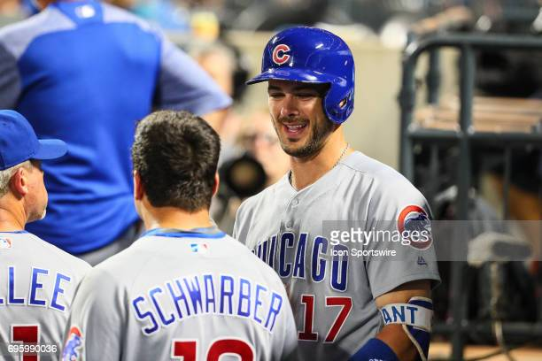 Chicago Cubs third baseman Kris Bryant talks with Chicago Cubs left fielder Kyle Schwarber in the dugout during the Major League Baseball game...