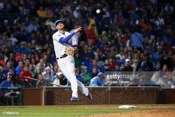 Chicago Cubs third baseman Kris Bryant throws out the St Louis Cardinals' Thomas Pham at first base during the fourth inning at Wrigley Field in...