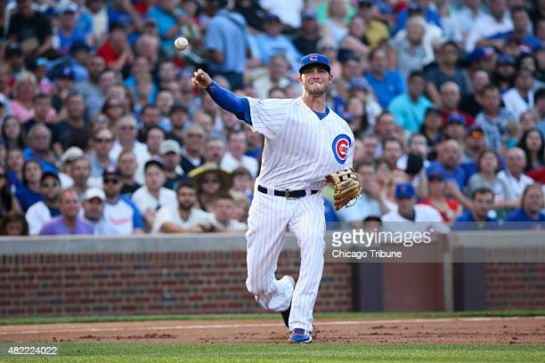 Chicago Cubs third baseman Kris Bryant throws to first base retiring the Colorado Rockies' Nick Hundley during the first inning at Wrigley Field in...