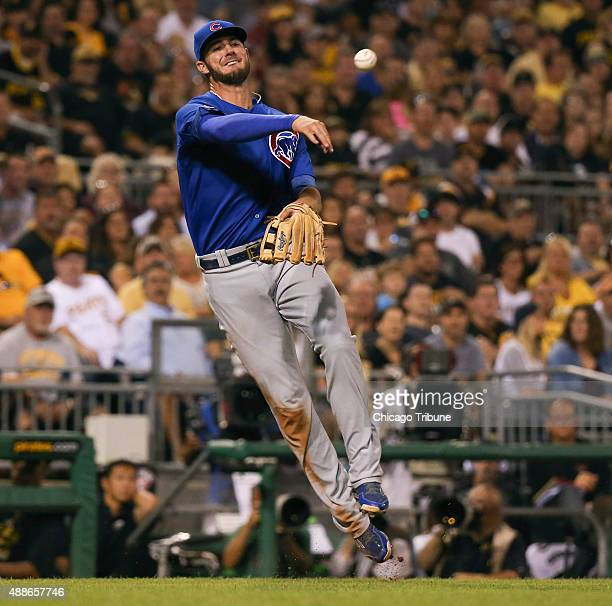 Chicago Cubs third baseman Kris Bryant throws to first on an infield single by the Pittsburgh Pirates' Starling Marte during the fourth inning at PNC...