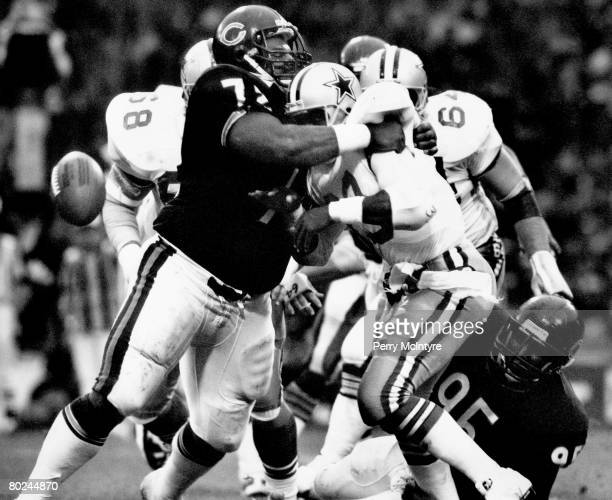 Chicago defensive tackle William Perry of the Chicago Bears tackles Hall of Fame running back Tony Dorsett of the Dallas Cowboys in a176 Chicago win...