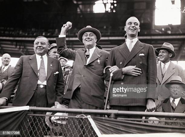 FDR takes time out from campaigning to attend the 1932 World Series at Chicago LR Mayor Cermak FDR tossing out the 1st ball and son James Roosevelt