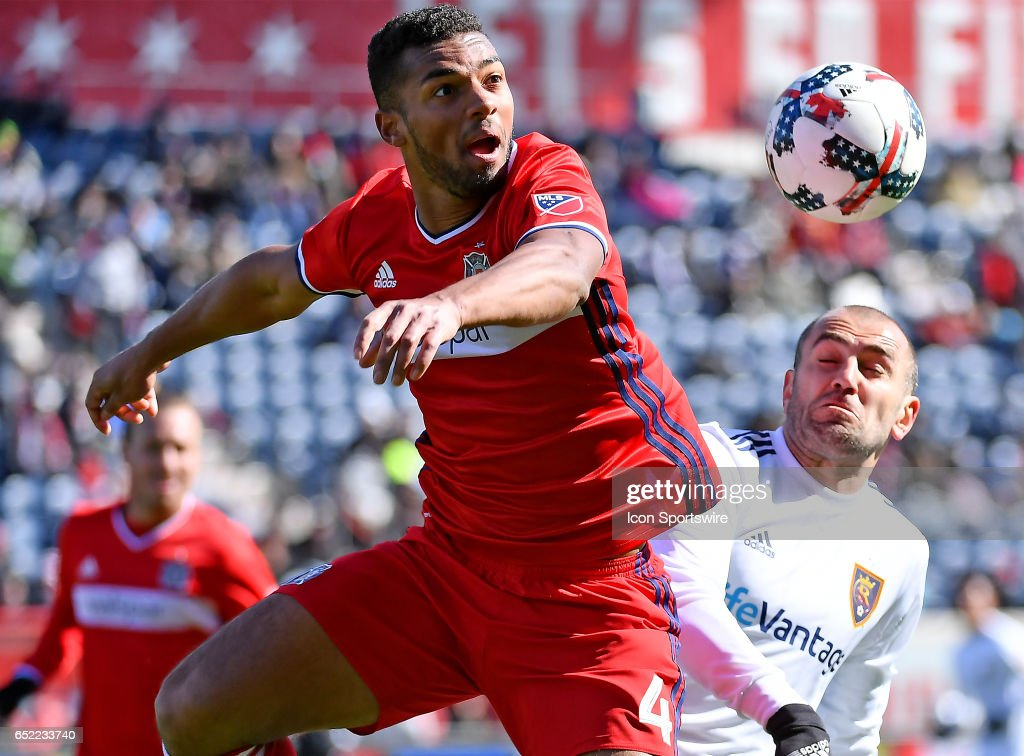 Chicago Fire defender Johan Kappelhof (4) and Real Salt Lake forward Yura Movsisyan (14) fight for the ball during the game between the Real Salt Lake and the Chicago Fire on March 11, 2017 at Toyota Park in Chicago, Illinois.