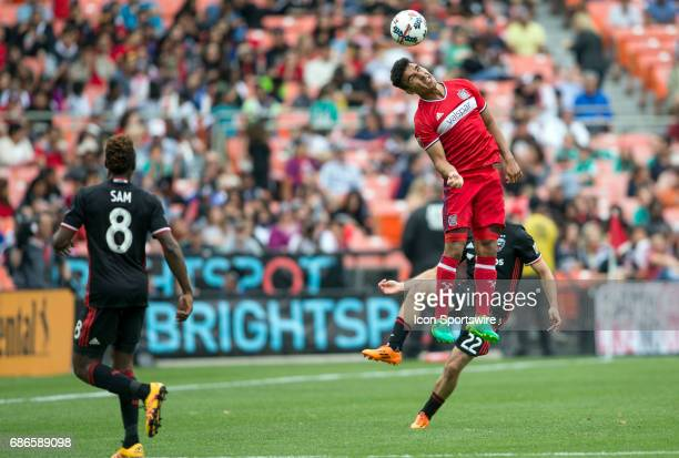 Chicago Fire defender Johan Kappelhof leaps high over DC United defender Chris Korb for a high pass during a MLS match between DC United and the...