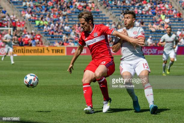 Chicago Fire defender João Meira and Atlanta United FC forward Hector Villalba battle for a ball in the first half during an MLS soccer match between...