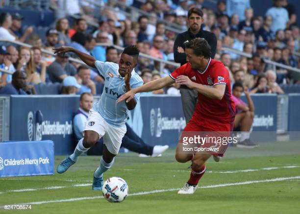 Chicago Fire defender Patrick Doody defends Sporting Kansas City forward Latif Blessing while head coach Veljko Paunovic looks on in the first half...