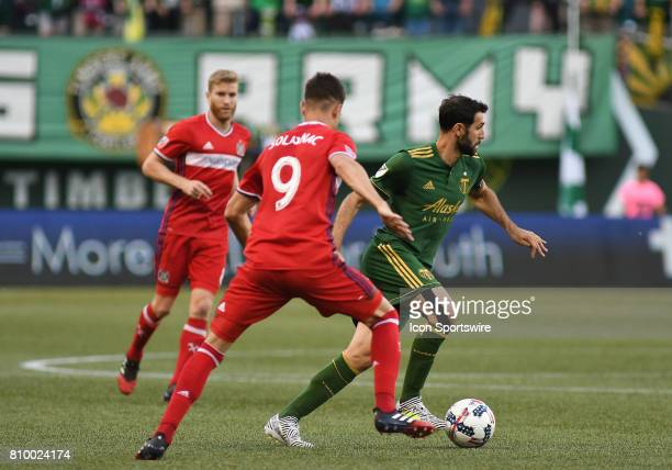 Chicago Fire F Luis Solignac looks to defend Portland Timbers MF Diego Valeri during a Major League Soccer match between the Chicago Fire and...