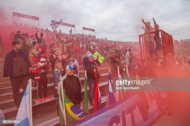 Chicago Fire fans celebrate a goal as red smoke rolls through 'The Harlem End' during a game between the Philadelphia Union and the Chicago Fire on...
