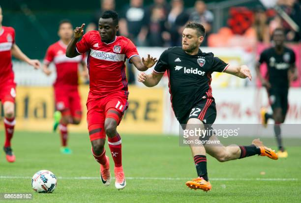 Chicago Fire forward David Accam and DC United defender Chris Korb pursue a loose ball during a MLS match between DC United and the Chicago Fire on...