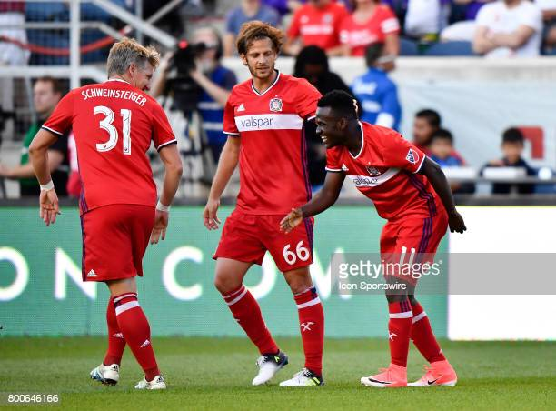 Chicago Fire forward David Accam Chicago Fire defender Joao Meira and Chicago Fire midfielder Bastian Schweinsteiger celebrate the goal of Chicago...