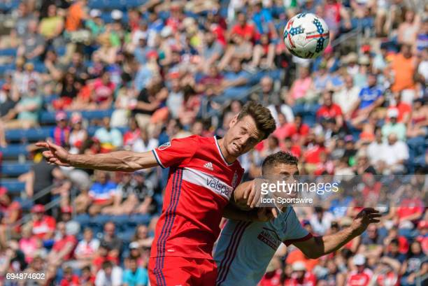 Chicago Fire forward Luis Solignac and Atlanta United FC midfielder Carlos Carmona battle for a ball in the first half during an MLS soccer match...