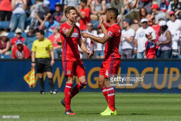 Chicago Fire forward Luis Solignac and Chicago Fire defender Johan Kappelhof celebrate a Solignac goal in the first half during an MLS soccer match...