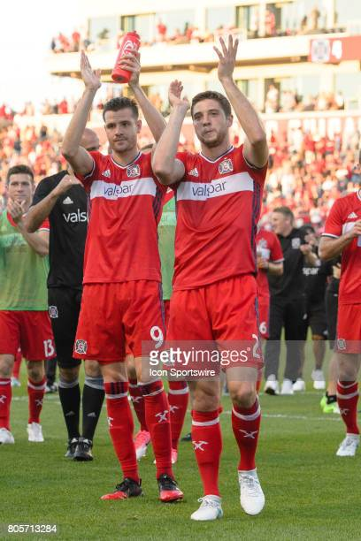 Chicago Fire forward Luis Solignac and Chicago Fire defender Matt Polster look to the crowd after an MLS soccer match between the Vancouver Whitecaps...