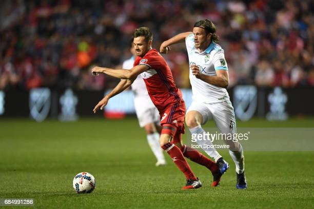 Chicago Fire forward Luis Solignac and Seattle Sounders defender Gustav Svensson battle for the ball during a game against the Seattle Sounders and...