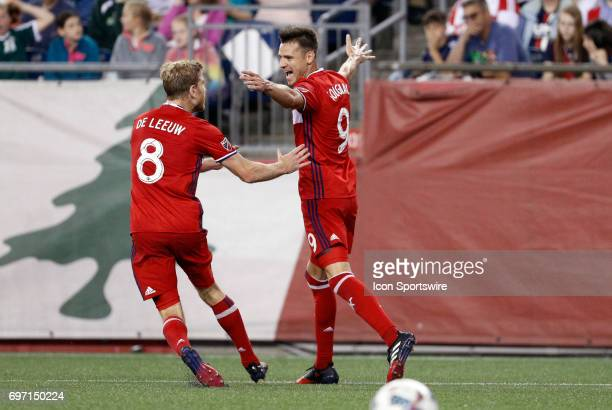 Chicago Fire forward Luis Solignac celebrates his goal with Chicago Fire forward Michael de Leeuw during a regular season MLS match between the New...