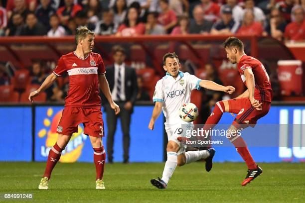 Chicago Fire forward Luis Solignac clears the ball next to Seattle Sounders forward Harrison Shipp and Chicago Fire midfielder Bastian Schweinsteiger...