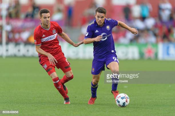 Chicago Fire forward Luis Solignac defends Orlando City FC midfielder Victor Giro in the first half during an MLS soccer match between Orlando City...