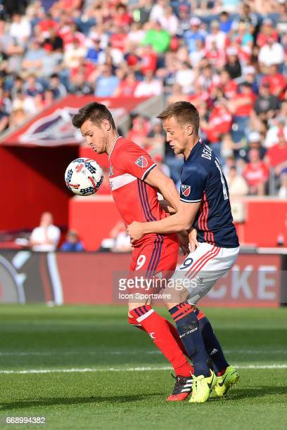 Chicago Fire forward Luis Solignac is defended by New England Revolution defender Antonio Delamea Mlinar during a game between the Chicago Fire and...