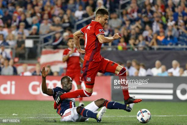 Chicago Fire forward Luis Solignac skips past New England Revolution defender Benjamin Angoua on the way to scoring the game winner during a regular...