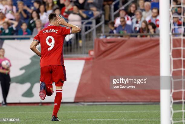 Chicago Fire forward Luis Solignac taunts the Revolution supporters after scoring the eventual game winner during a regular season MLS match between...
